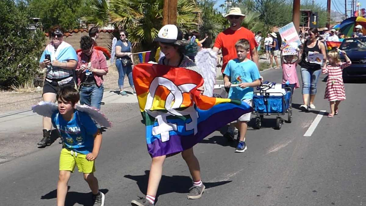 Photo of families walking in Tucson Pride 2019 parade